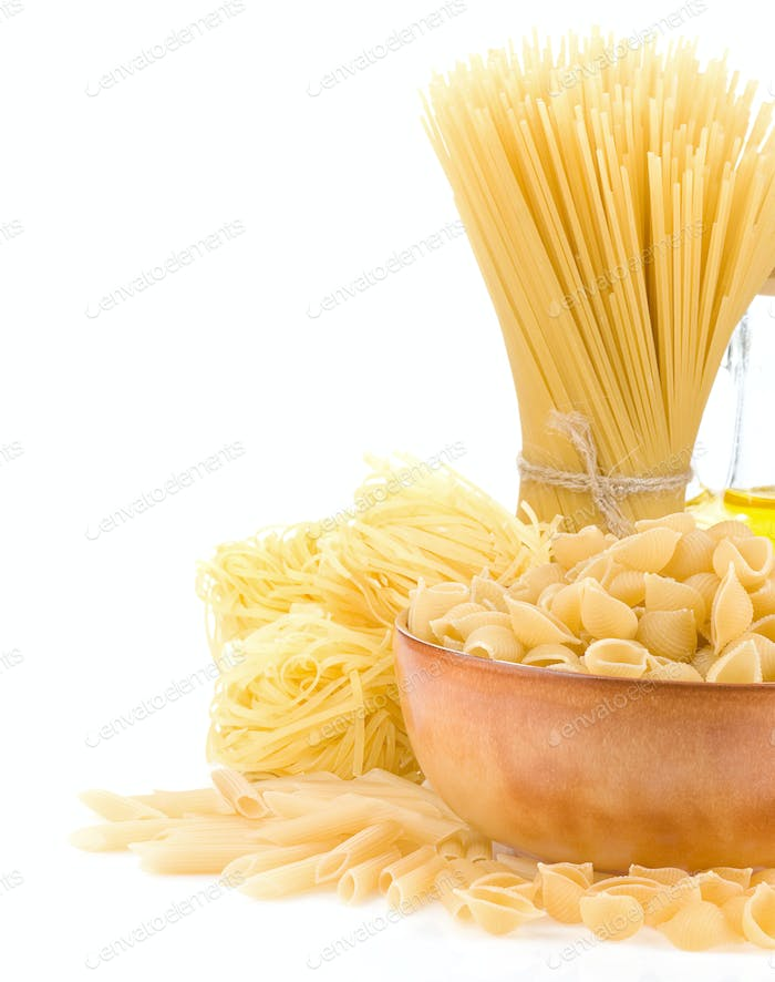 pasta and wooden plate on white