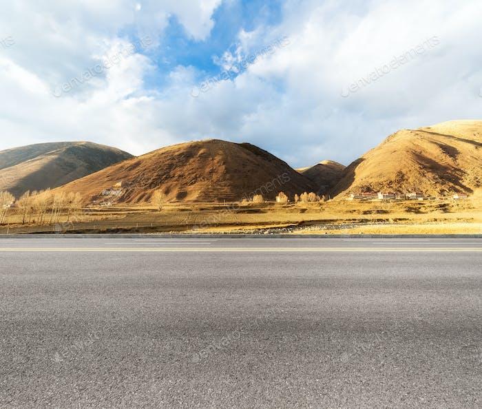 empty asphalt road in tibetan area