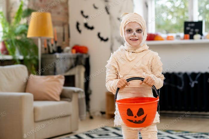 Little mummy with candy bucket