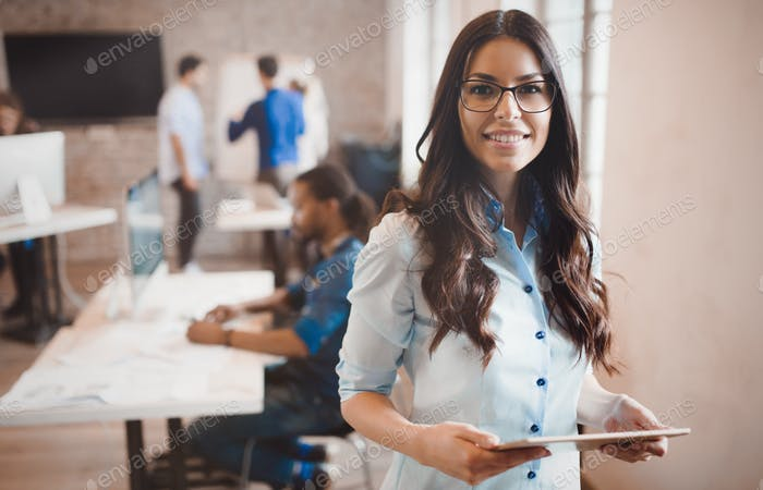Beautiful businesswoman portrait in modern  company offic