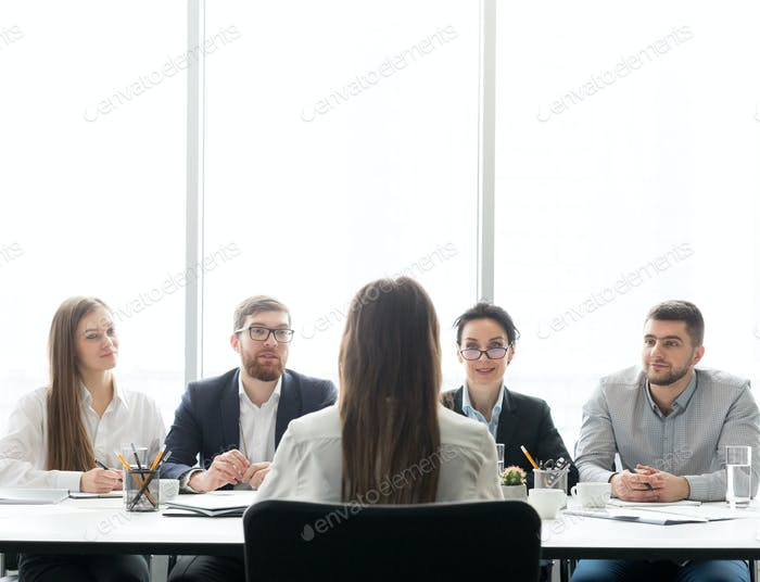 HR managers having job interview with female candidate