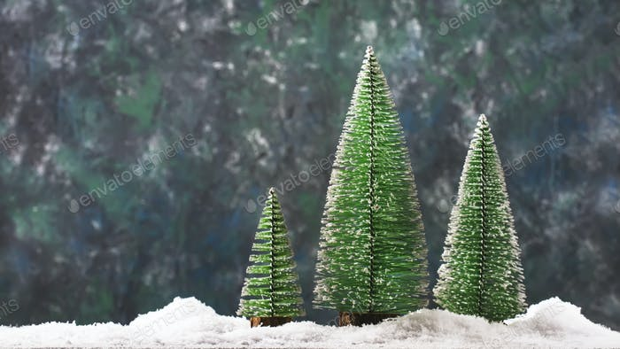 Little Christmas tree toys in snowdrift, winter New Year concept
