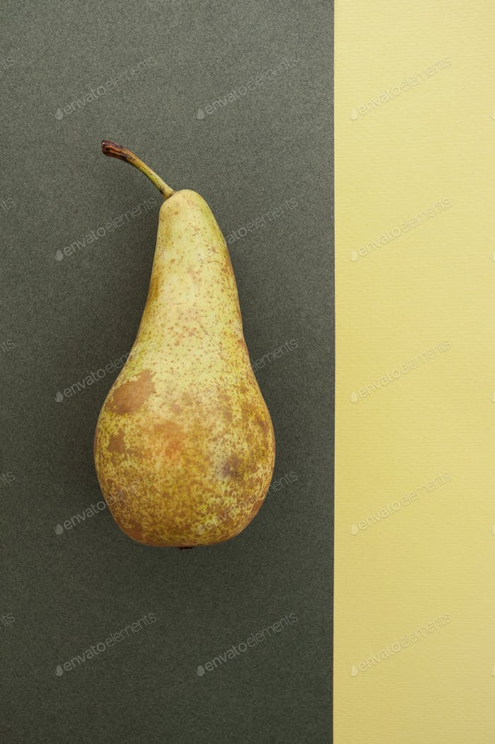 Pear varieties Conference on a gray-yellow textured background w