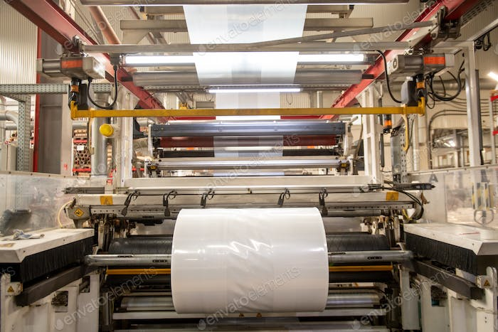 Huge industrial machine with rolled newly produced transparent polyethylene film