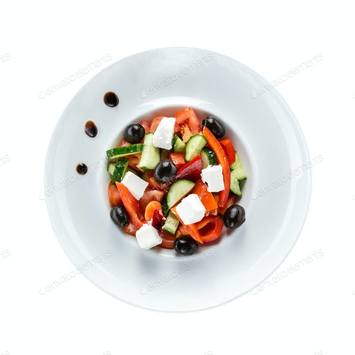 Greek salad in plate isolated over white. With clipping path.