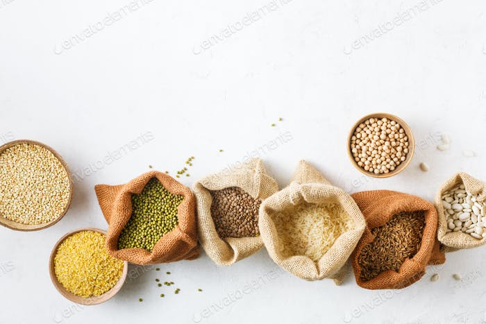 Various kinds of natural grains and cereals in fabric bags