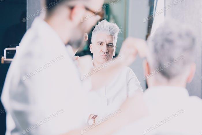 Stylish mature man at barber
