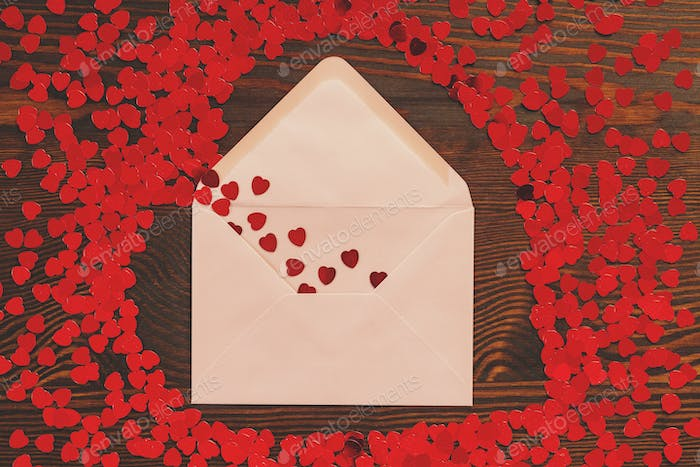 Envelope with heart confetti