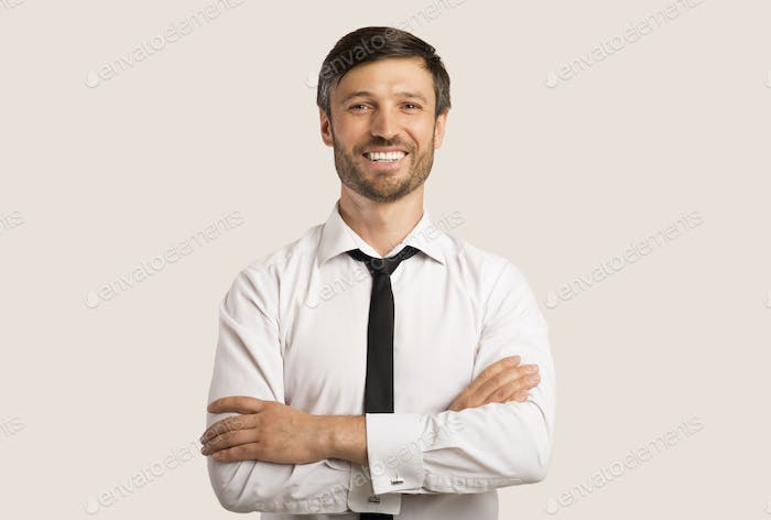Business Guy Smiling Crossing Hands Standing Over White Background