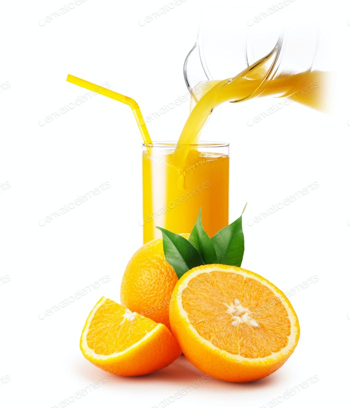 Orange juice pouring into a glass and oranges