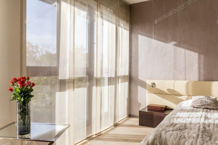 Spacious bedroom in beige colours