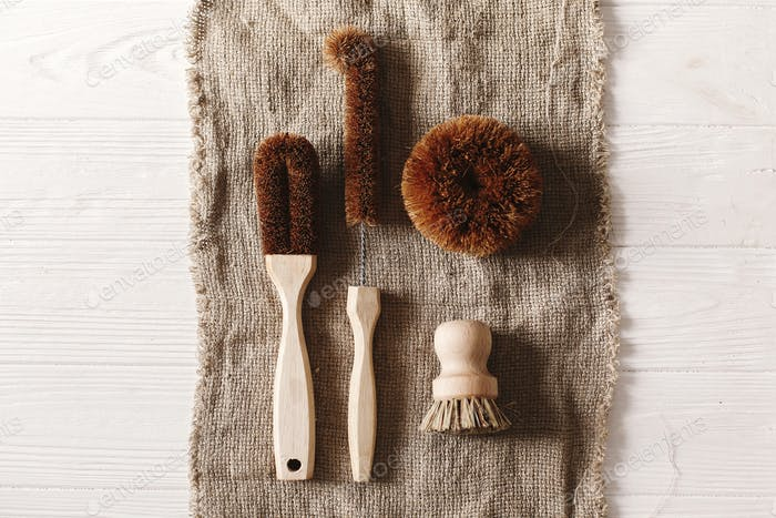 Eco natural coconut brushes  flat lay on rustic background