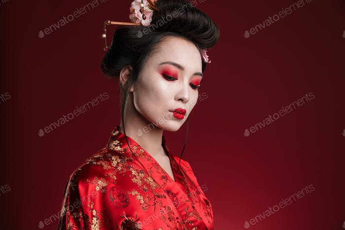 Image of attractive asian geisha woman in traditional japanese kimono