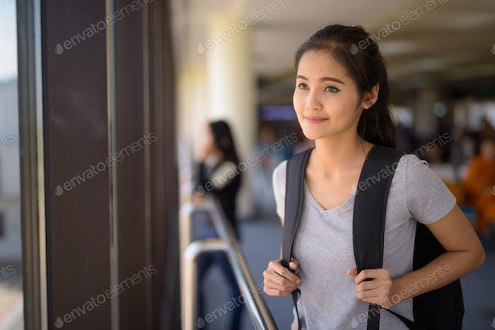 Young beautiful Asian tourist woman enjoying vacation