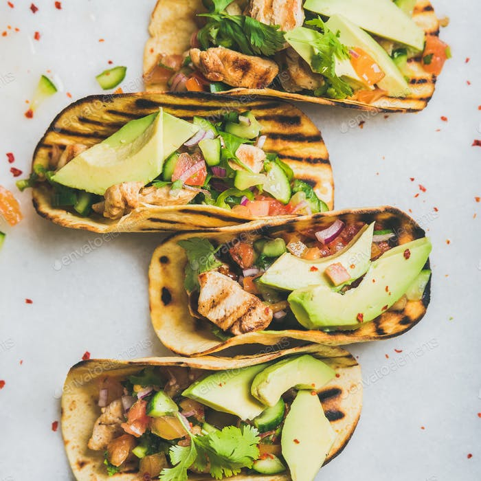 Healthy corn tortillas with grilled chicken fillet, avocado, fresh salsa
