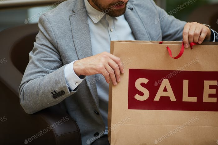 Unrecognizable Man Holding Shopping Bag