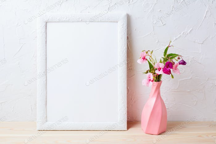 White frame mockup with flowers in swirled pink vase