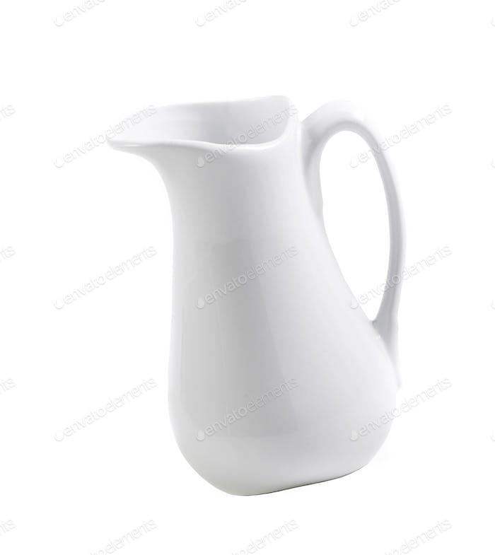 White milk pitcher isolated on white background