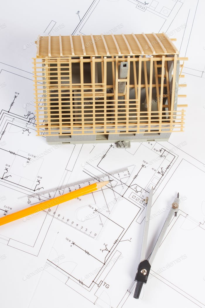House under construction and accessories for drawing on electrical diagrams for project