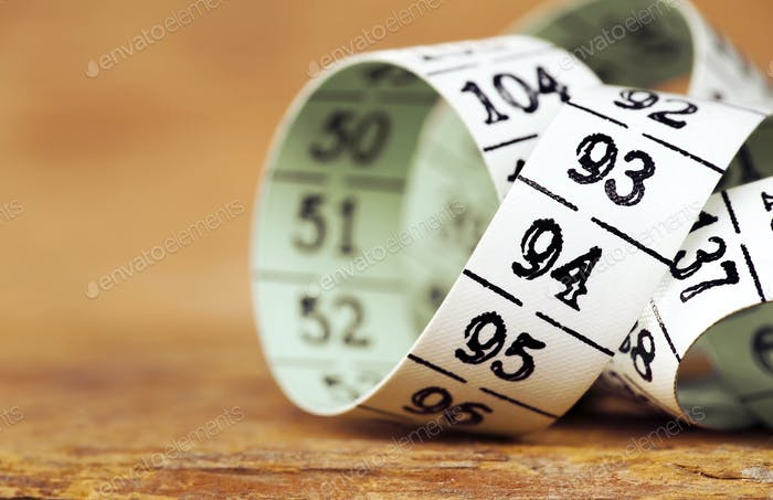 Weight loss, diet - measuring tape close-up