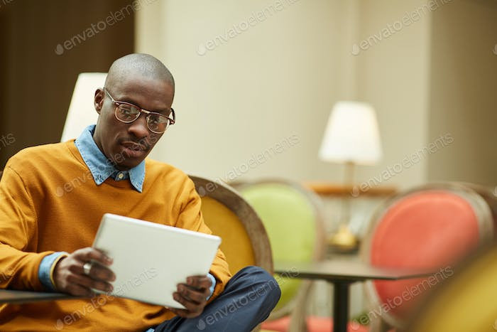 Modern African Man Relaxing in Cafe