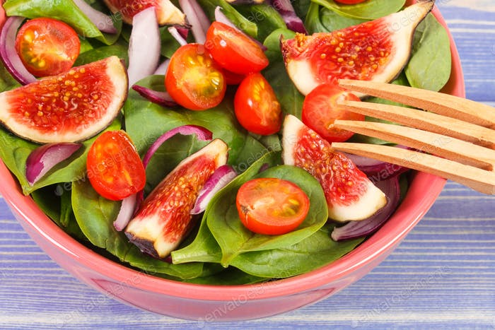 Fresh fruit and vegetable salad with wooden fork, healthy lifestyle and nutrition concept