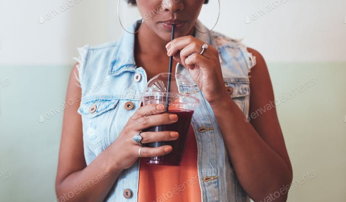 African woman drinking juice