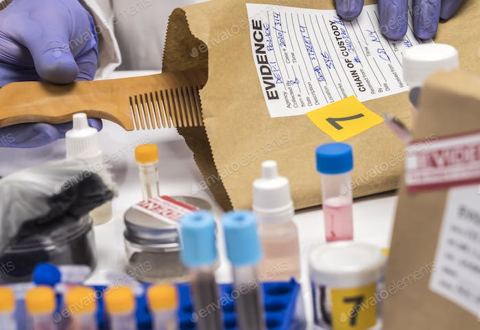Scientist Police hold murder victim comb to find dna in crime lab, concept image