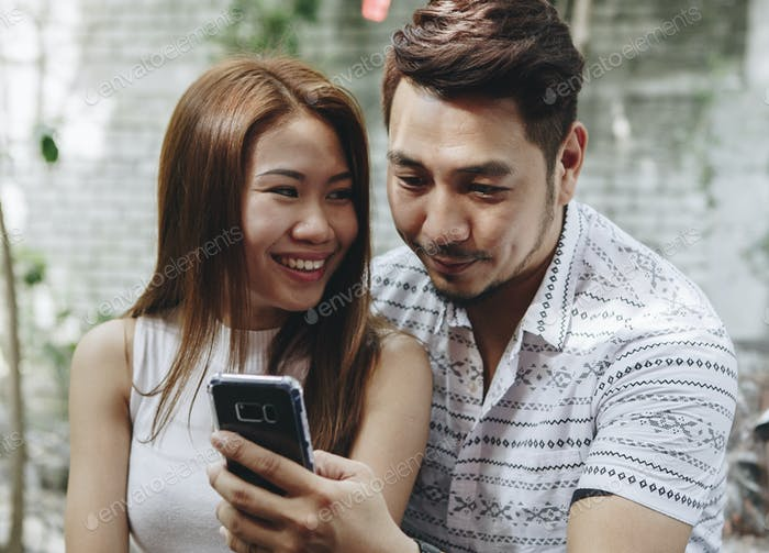 Young couple using a phone together