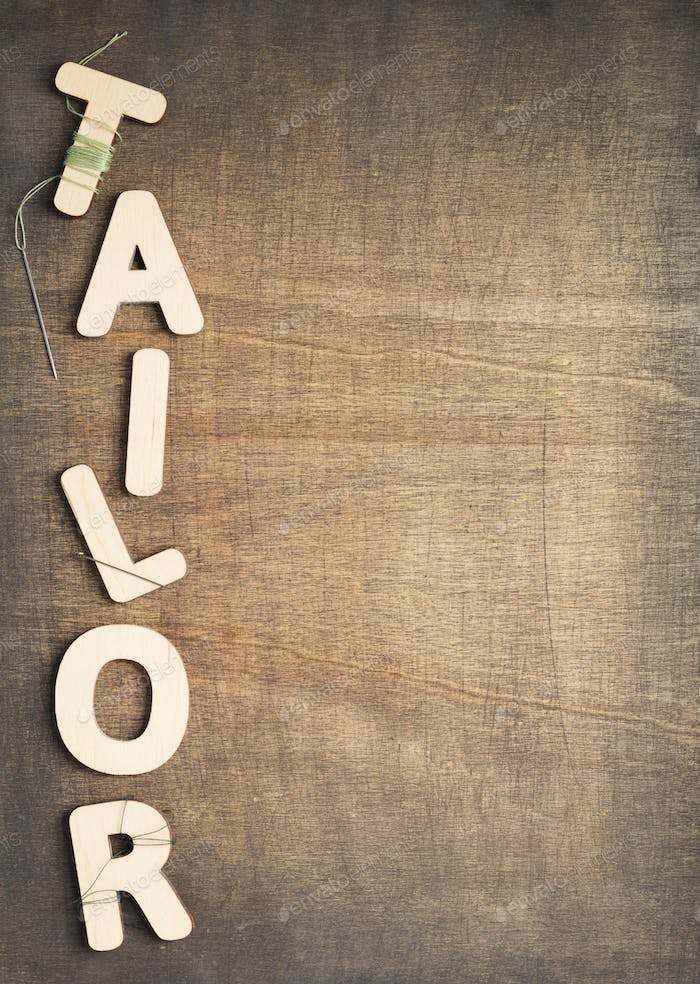 tailor letters on wooden table