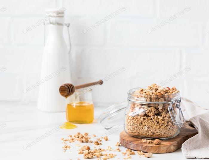 Granola, muesli with vegetable milk and honey. Breakfast, snack.Concept of healthy