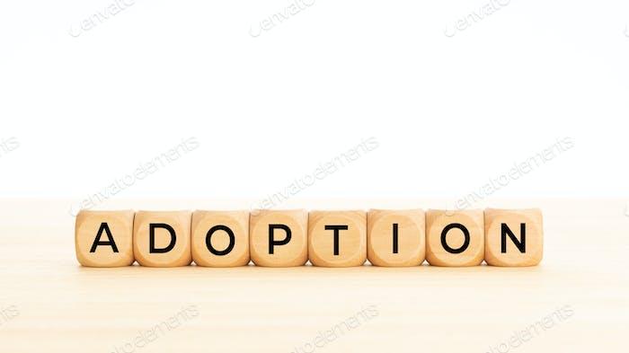 Adoption word on wooden blocks