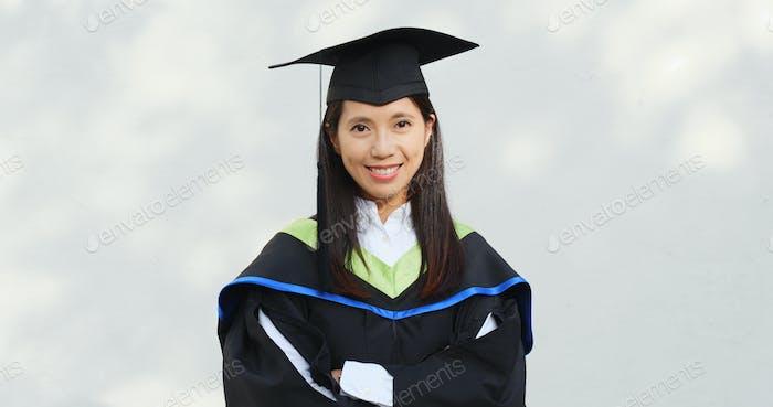 Woman wearing graduation gown