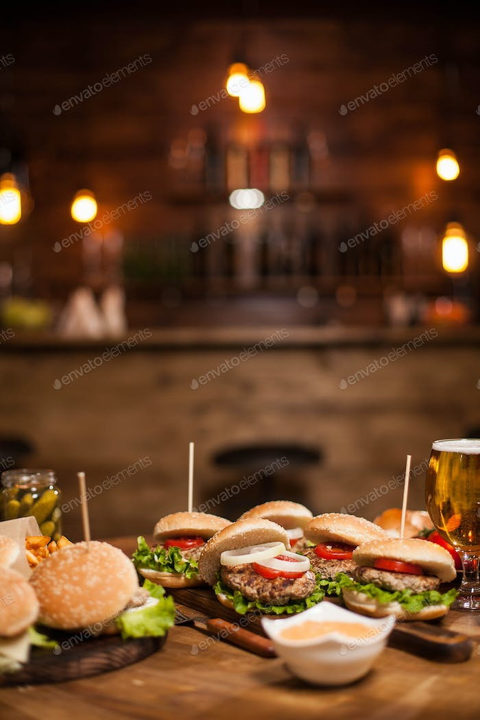 Delicious burgers and cheesburgers on a table