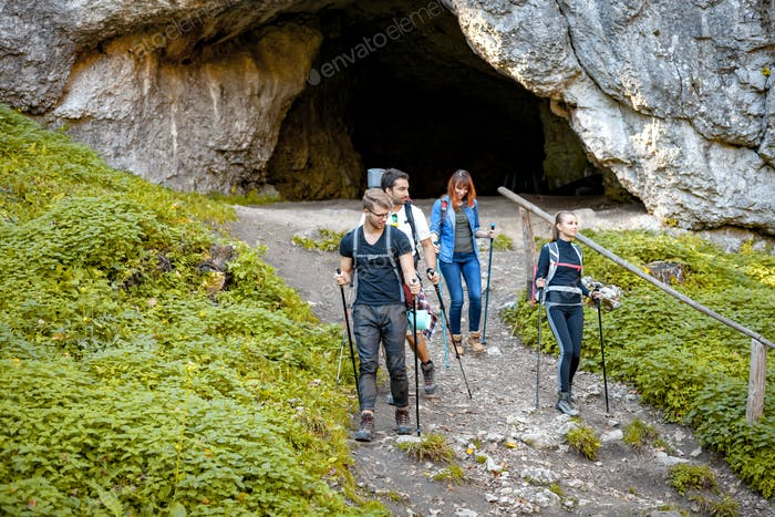 Group of hikers exploring mountain, trekking in nature