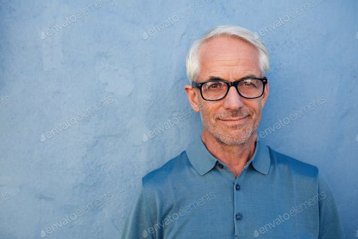 Handsome senior man with glasses looking at camera