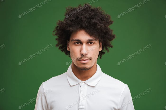 Handsome serious young curly man