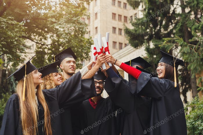 Group of multiethnic graduates celebrating