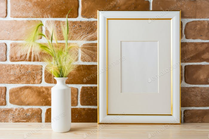 Gold decorated frame mockup with ornamental grass exposed brick