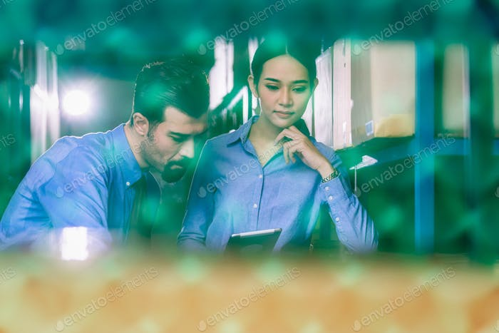 Manager of warehouse worker assign and command in serious look to assistant manager woman