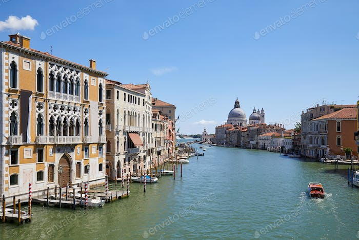 Grand Canal in Venice at midday with Saint Mary of Health basilica