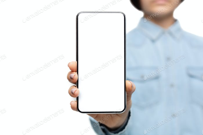 Smartphone with blank screen in hands of unrecognizable woman