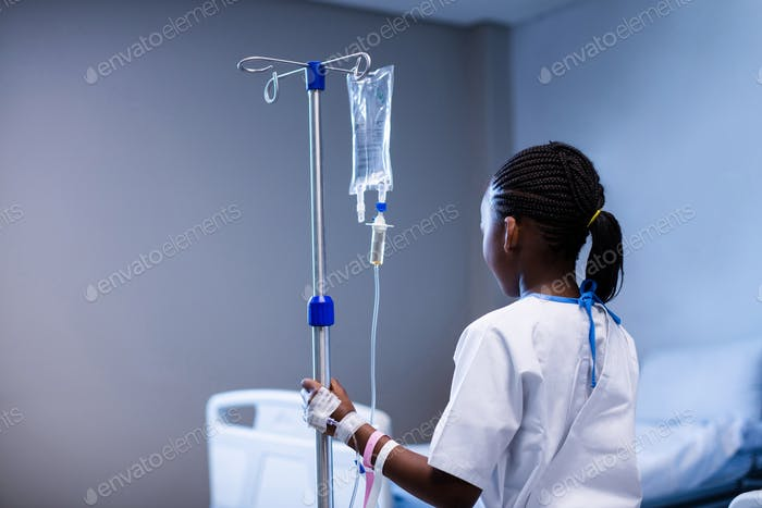 Patient holding IV stand