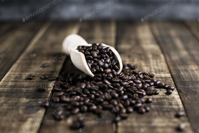 coffee beans with wooden scoop
