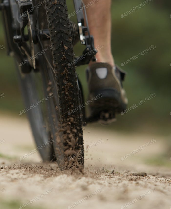Cyclist on dirt trail