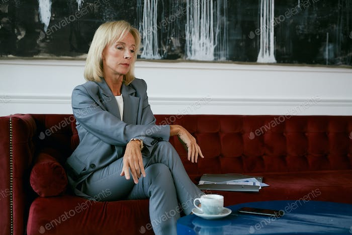Mature Businesswoman in Elegant Interior