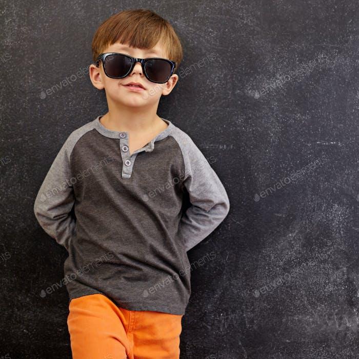 Smart little boy in shades smirking