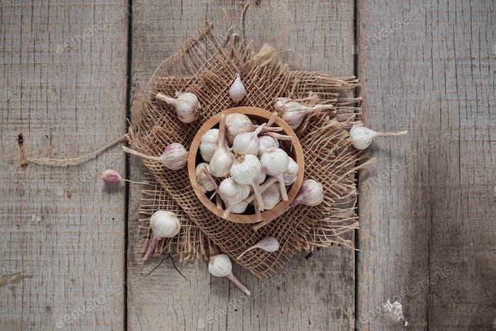 Garlic on wooden floor