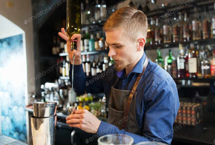 barman with shaker preparing cocktail at bar