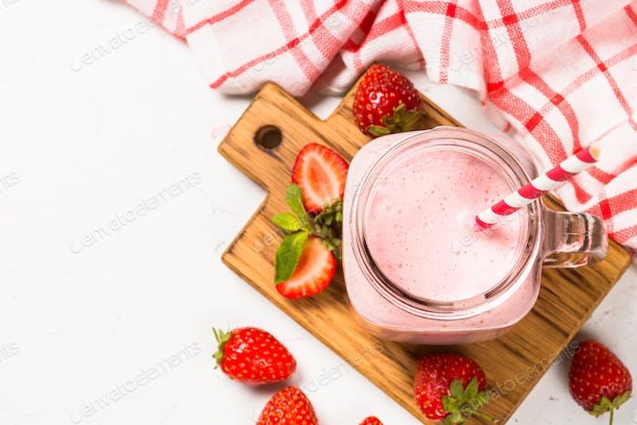 Strawberry milkshake or smoothie in mason jar